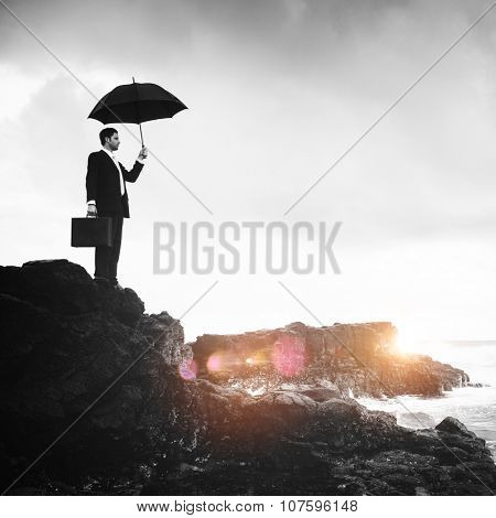 Lonely Businessman Standing by the Beach Concept