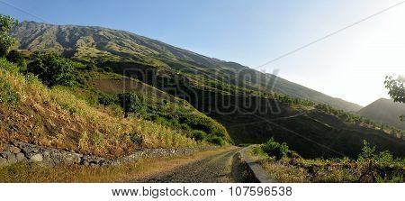 Road Circumnavigates Mountainous Landscape