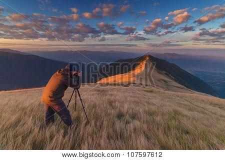 photographer take photo on mountain