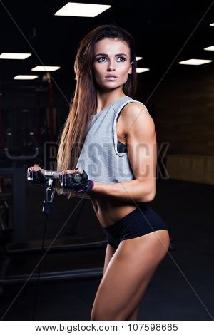 Beautiful Brunette During Workout In Gym