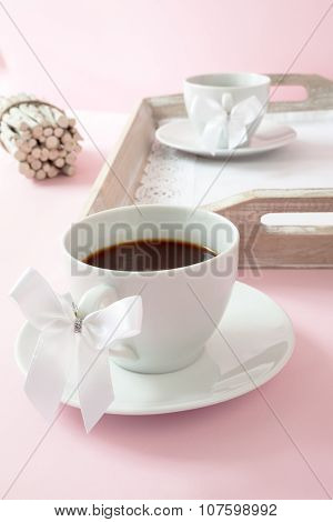 Coffee cups with white ribbon
