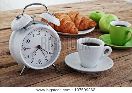 Coffee With Alarm Clock On A Rustic Wooden Table