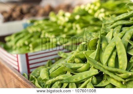 Snow peas for sale at an outdoor market in Chinatown, New York City.