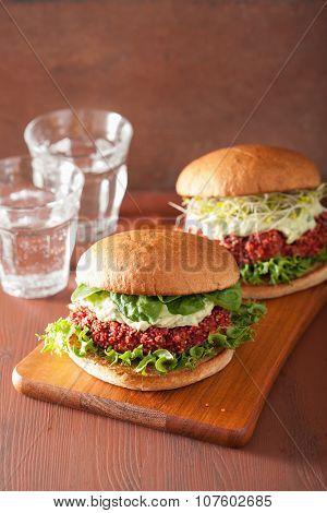 veggie beet and quinoa burger with avocado dressing