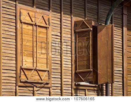 Image Of An Old Wooden Windows With Shutters