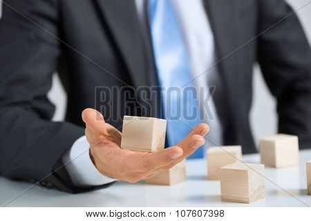 Businessman making tower