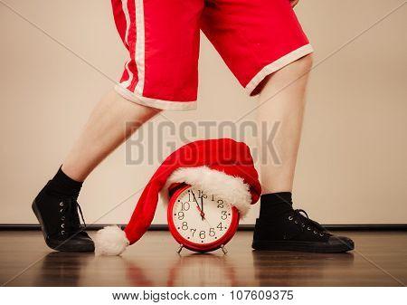 Closeup Of Man With Alarm Clock. Christmas Time.