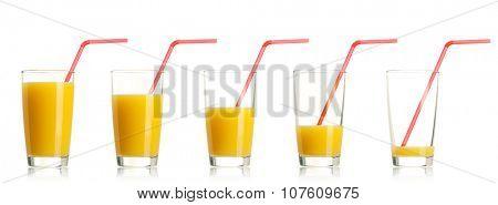 Set of glass of fresh orange juice with straw on white background