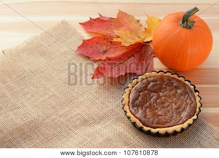 Small Pumpkin Pie With Gourd And Autumn Leaves
