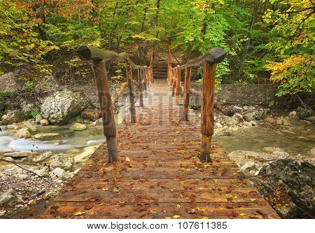 wooden bridge over a mountain stream