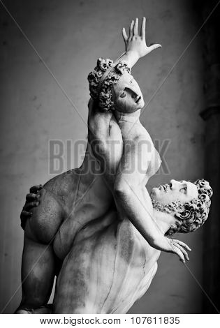 Ancient style sculpture of The Rape of the Sabine Women in Loggia dei Lanzi in Florence, Italy. Black and white