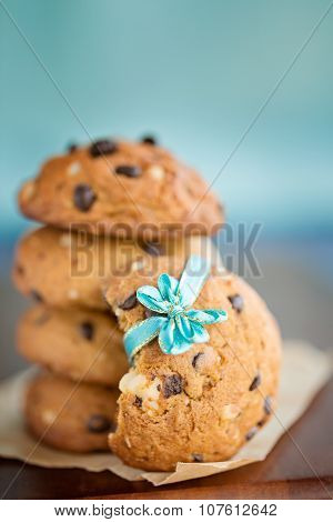 Stacked Chocolate Chip Cookies With Small Blue Ribbon