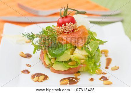 Salmon And Avocado Salad Garnish With Cedar Nut Dressing