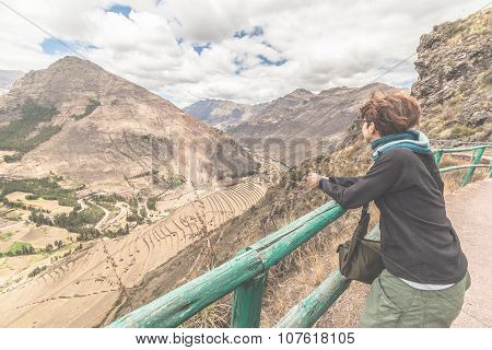 Tourist Looking At Inca Terraces Of Pisac, Peru, Filtered Image