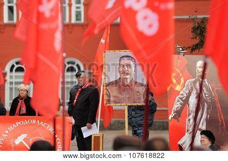 Orel, Russia - November 7, 2015: Communist Party Meeting. Stalin Portrait, Red Flags, Lenin Portrait