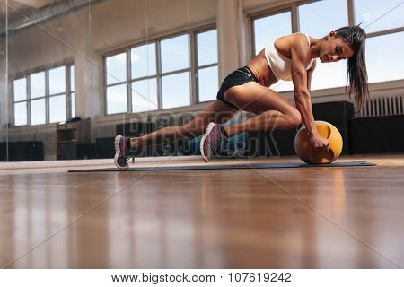 Muscular Young Woman Doing Workout At Gym