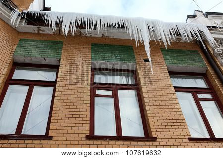Icicles Which Are Hanging Down From A Roof.