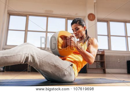 Muscular Young Woman Doing Crossfit Workout In Gym