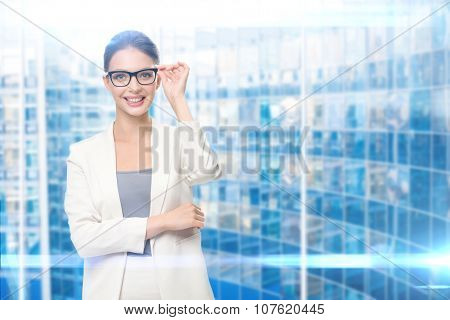 Portrait of business woman wearing glasses, on blue background. Concept of leadership and success