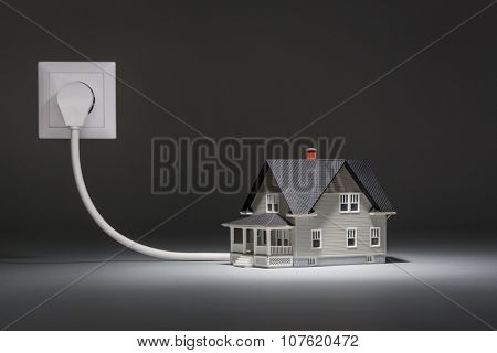 House architectural model connected to electricity