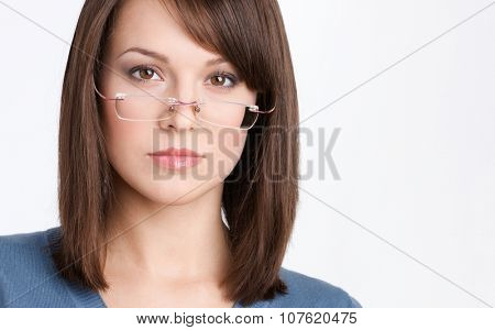 Front view of beautiful business woman in glasses, isolated on white