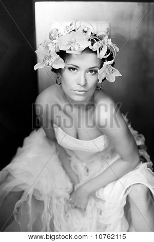 Portrait Of Sexual Brunette With Flowers In Hairs In Blackly - White Color