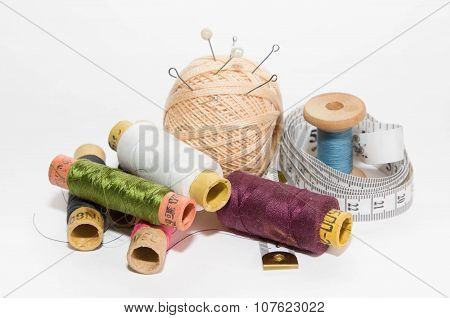Ball  Threads With Needles And Pins, Centimeter Of The Tailor And The Coil Of Multi-colored Threads