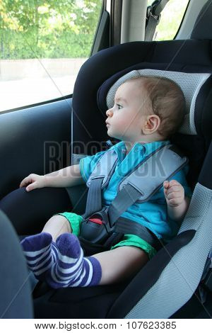 A baby boy in car seat for safety