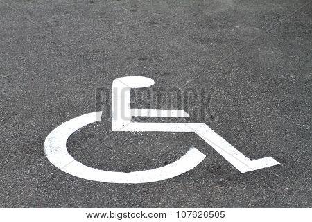 Closeup Invalid Sign On Parking Asphalt