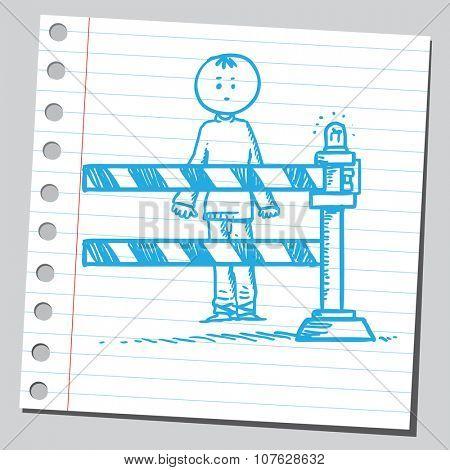 Man behind road barrier