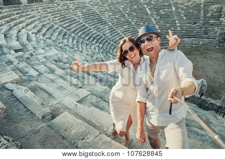 Positive Young Couple Take Self Photo In Side Amphitheatre