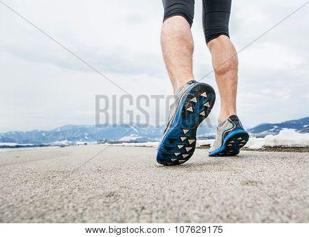 Close Up Sprinter Legs On Asphalt