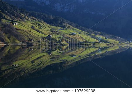 Farmland With Houses Reflecting In Lake Wagital