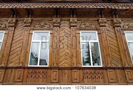 The Facade Of An Old Wooden House After Restoration