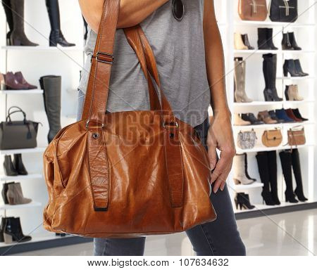 Shopping woman with bag in a shopping mall.