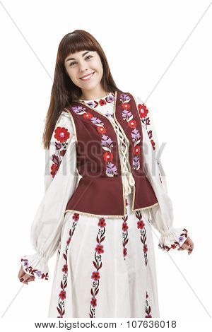 Portrait Of Smiling Brunette Lady Posing In National Flowery Costume. Isolated Over White