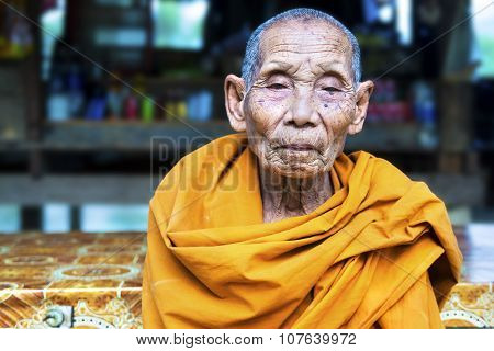 Portrait Of Old Buddhist Monk Near Vang Vieng, Laos