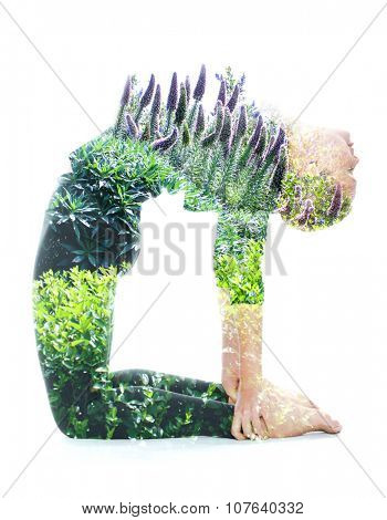 Double exposure portrait of a young woman performing yoga asana, combined with photograph of nature