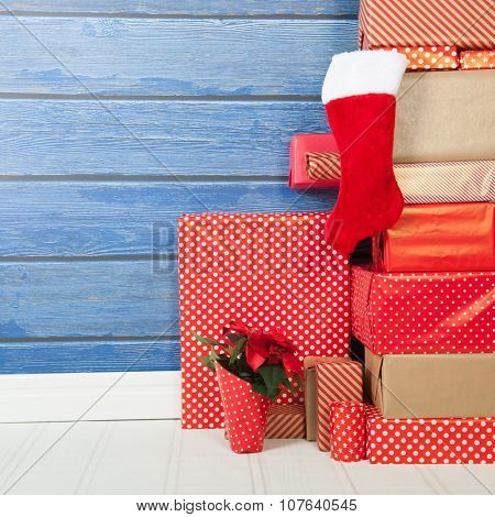 Christmas gift and stocking wrapped in red paper