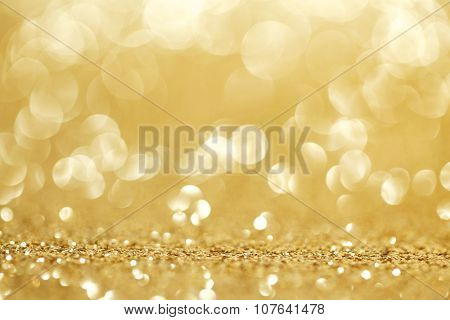 Abstract golden shiny glitter bokeh christmas background