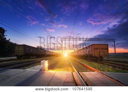 Cargo train platform at night. Railroad in Ukraine. Railway station.