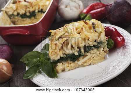 Pasticcio or pastitsio, oven baked pasta with zucchini and chard