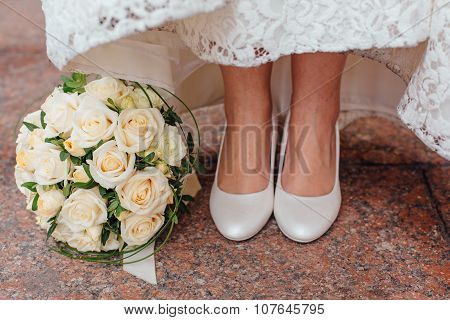 Bride's Feet And Bouquet