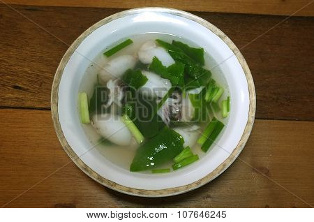 Plain clear soup of squid stuffed with minced pork and vegetable