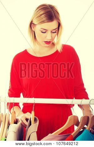 Young woman deciding what to put on.