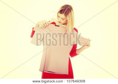Young woman deciding what to buy.