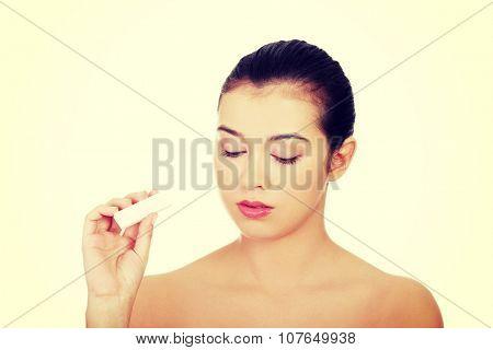 Sad woman with pregnancy test.
