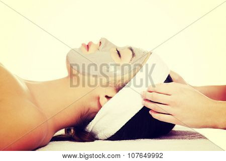 Beautiful young relaxed woman enjoy receiving head massage at spa saloon