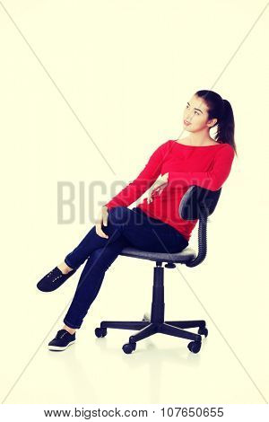Young happy woman sitting on a wheel chair.