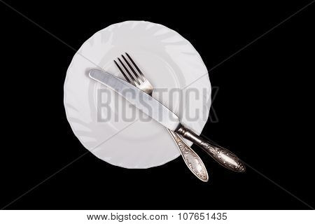 Etiquette sign. Plate, fork, knife top view isolated on black